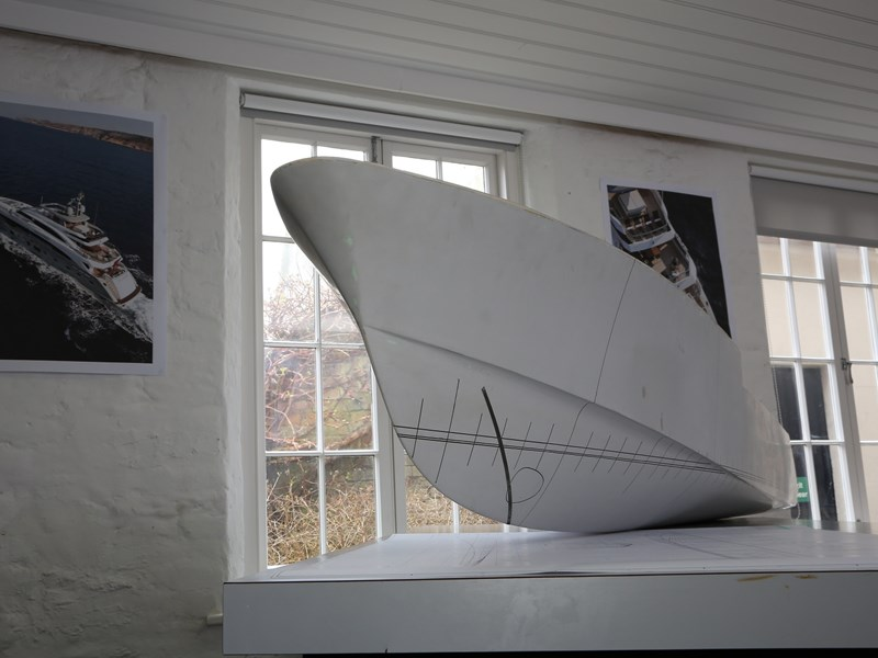 A large model of a ship showing its underside and hull